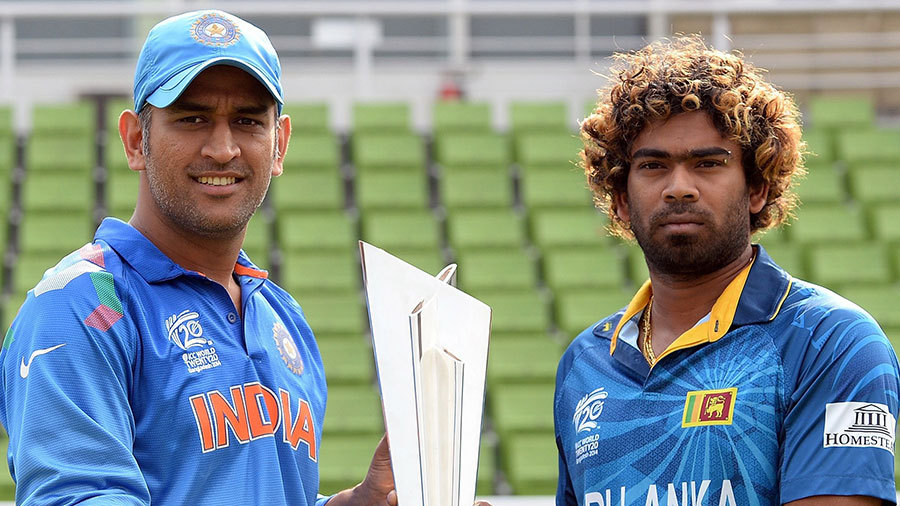 Dhoni And Malenga With The Trophy - World T20 2014